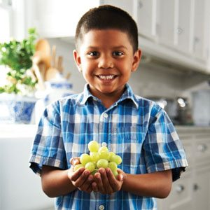 Boy Holding Grapes